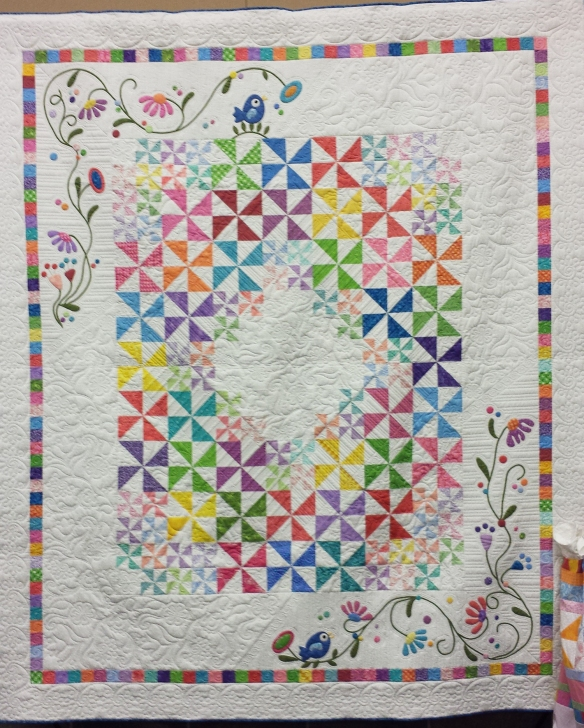 2014 Raffle Quilt titled 'Pinwheel Paradise' by the Carquinez Strait Stitchers